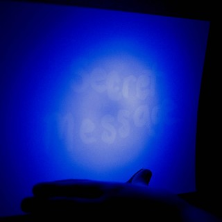 Secret glowing message using invisible ink