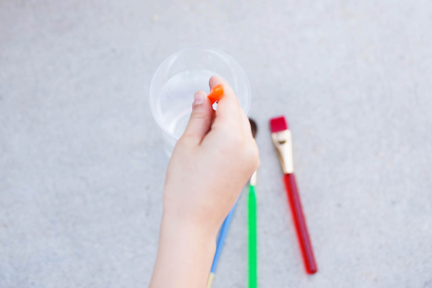 Paint with water - a super simple summer activity to keep kids busy  and you likely have everything you need already!
