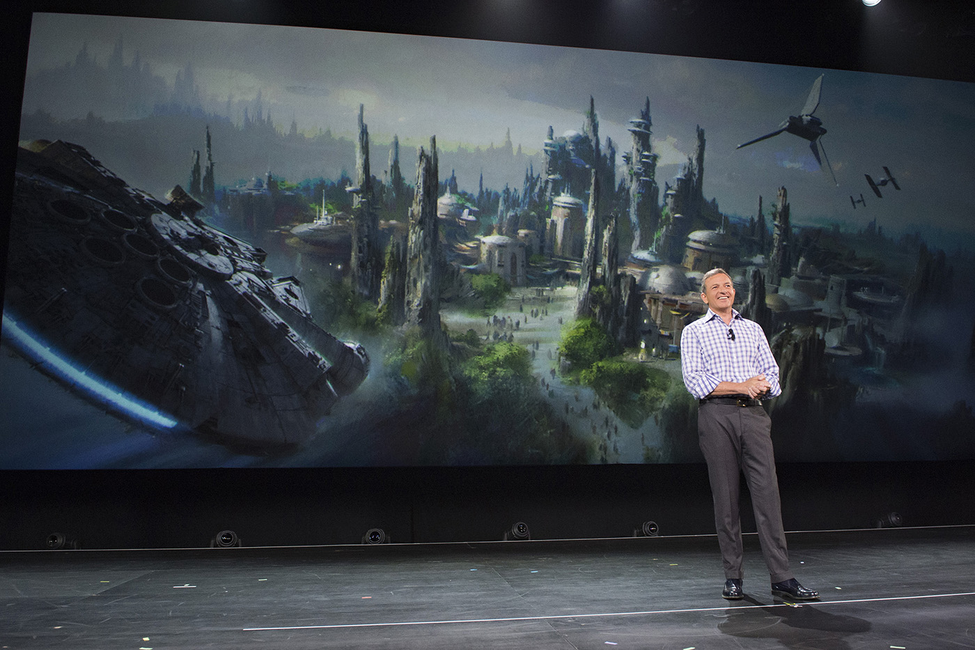 Walt Disney Company Chairman and CEO Bob Iger announced at D23 EXPO 2015 that Star Wars-themed lands will be coming to Disneyland park in Anaheim, Calif., and Disney's Hollywood Studios in Orlando, Fla., creating Disney's largest single-themed land expansions ever at 14-acres each, transporting guests to a never-before-seen planet, a remote trading port and one of the last stops before wild space where Star Wars characters and their stories come to life. These authentic lands will have two signature attractions, including the ability to take the controls of one of the most recognizable ships in the galaxy, the Millennium Falcon, on a customized secret mission, and an epic Star Wars adventure that puts guests in the middle of a climactic battle. (Richard Harbaugh/Disney Parks)