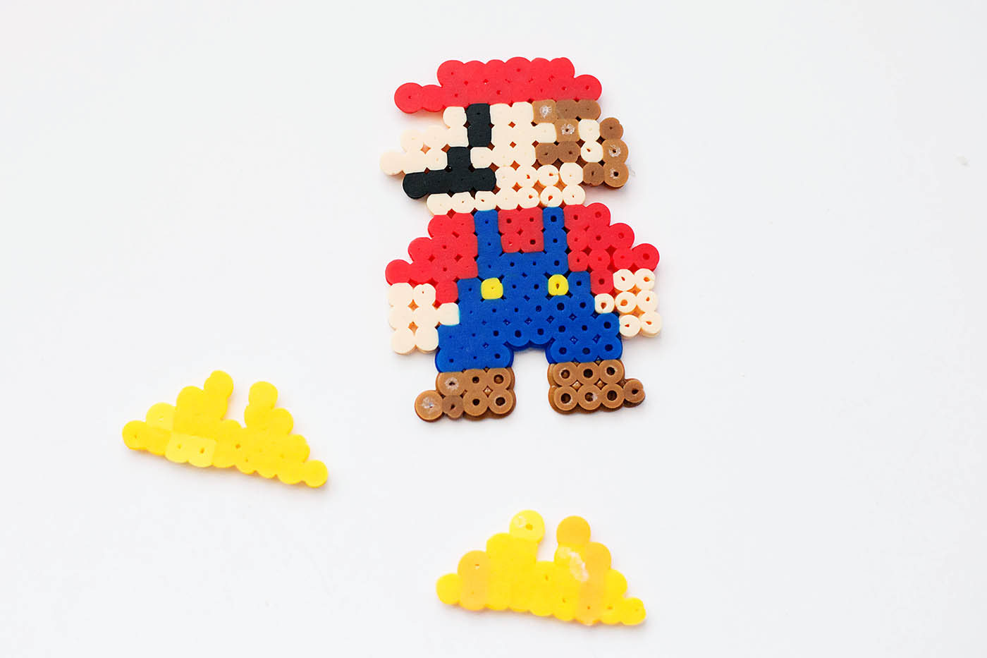 Stand up Perler bead characters. This one uses Mario but make any of your favorite characters stand!