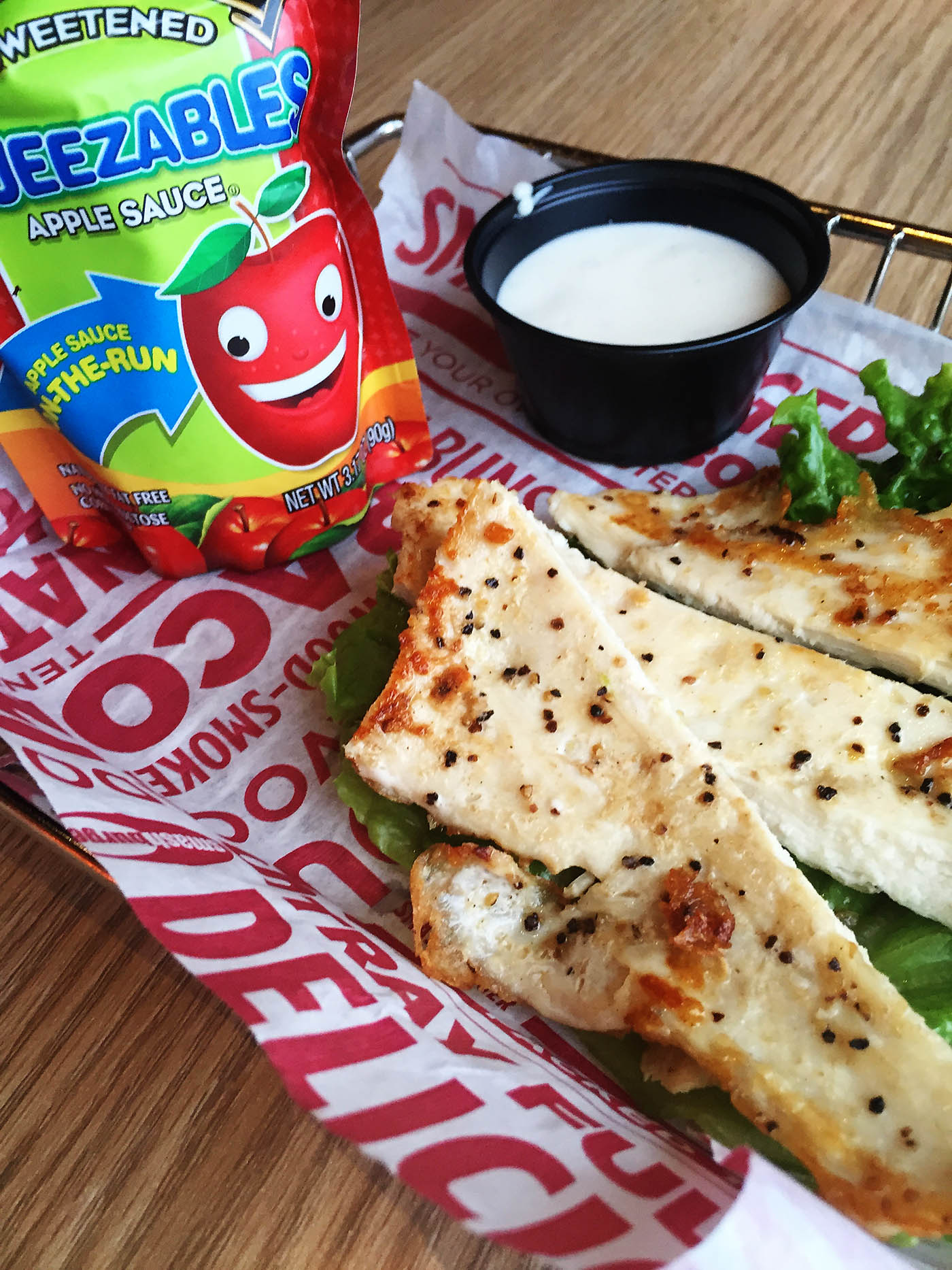 Smashburger now has grilled chicken strips and unsweetened applesauce on their kids menu!