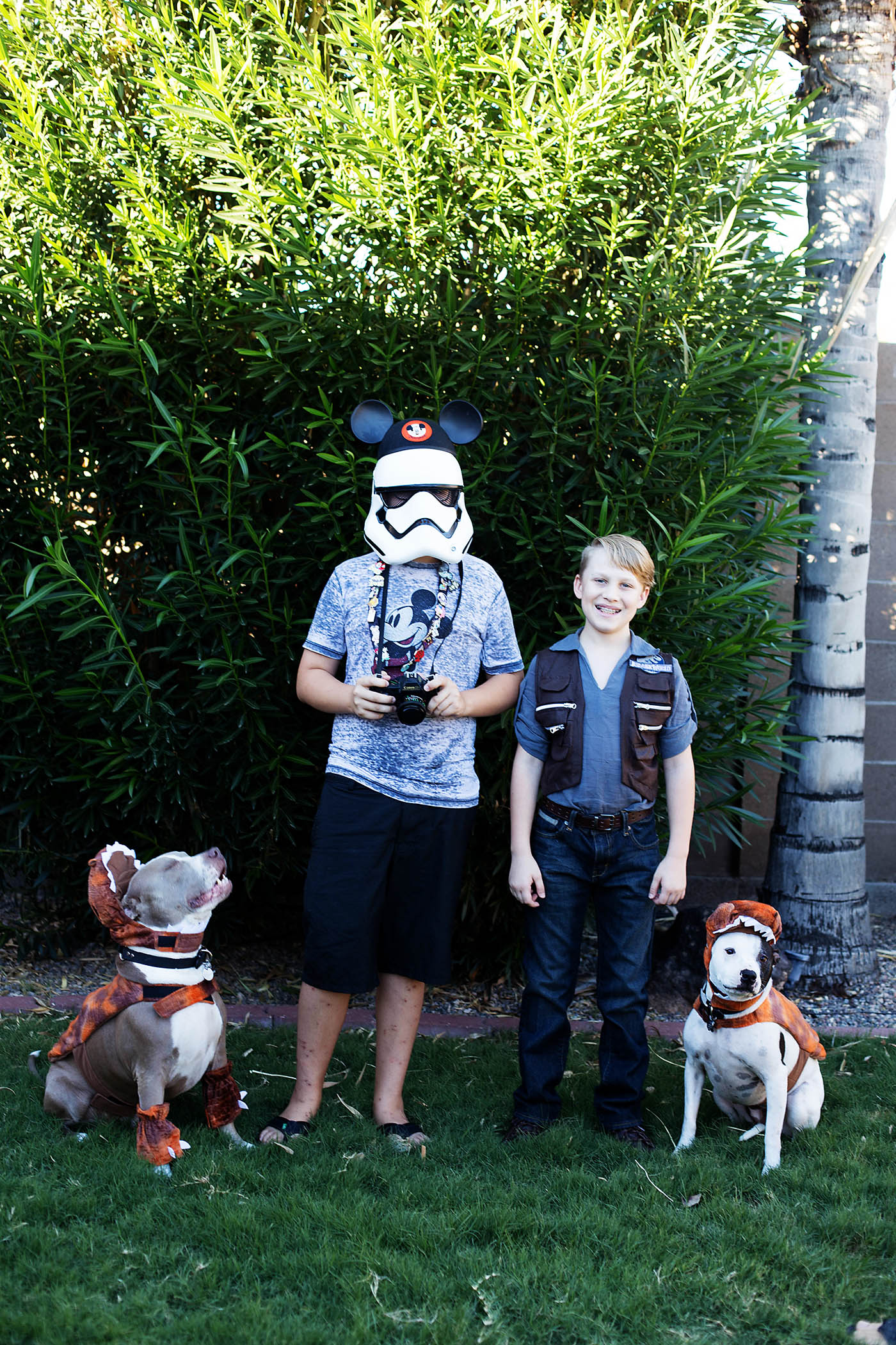 "Owen Grady with ""raptor"" dogs and a Storm Trooper going to Disneyland"