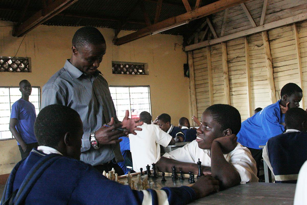 Robert Katende and Phiona Mutesi at Robert's chess program