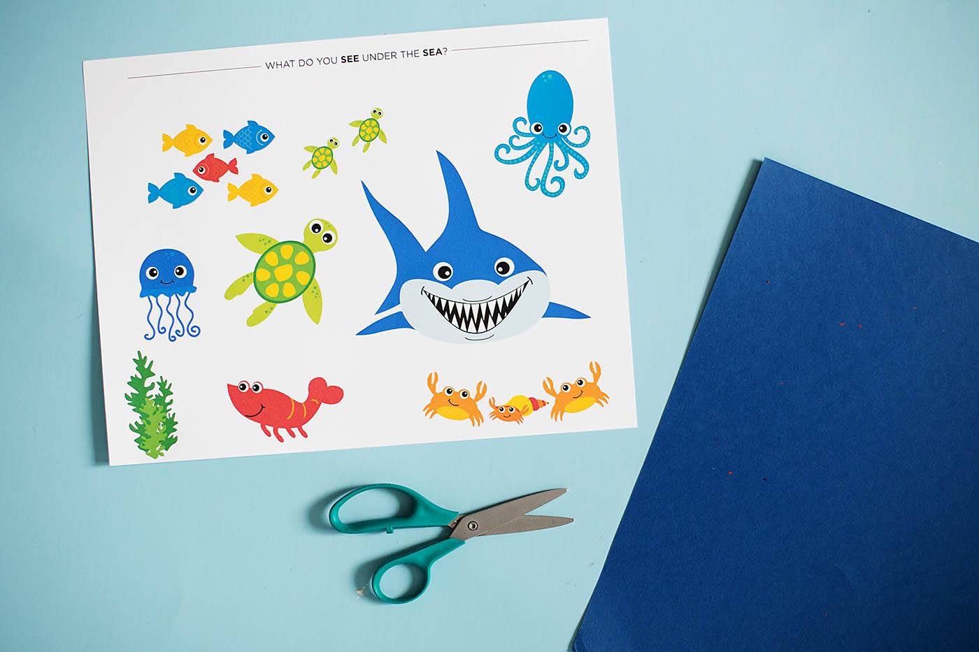 An ocean themed cutting craft perfect for kids learning to use scissors a 4 year-old milestone!