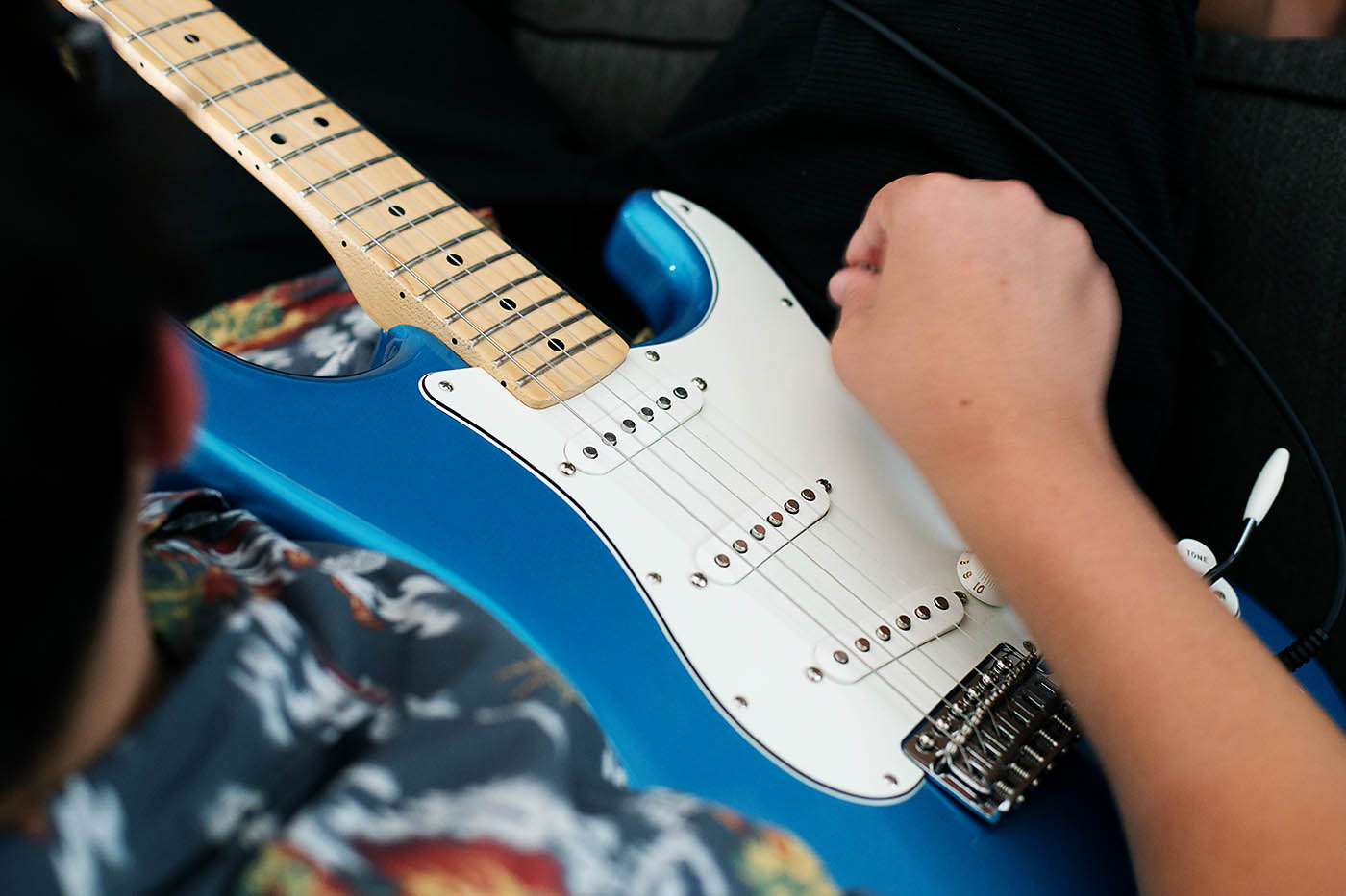 Learn to play guitar online with Fender Play