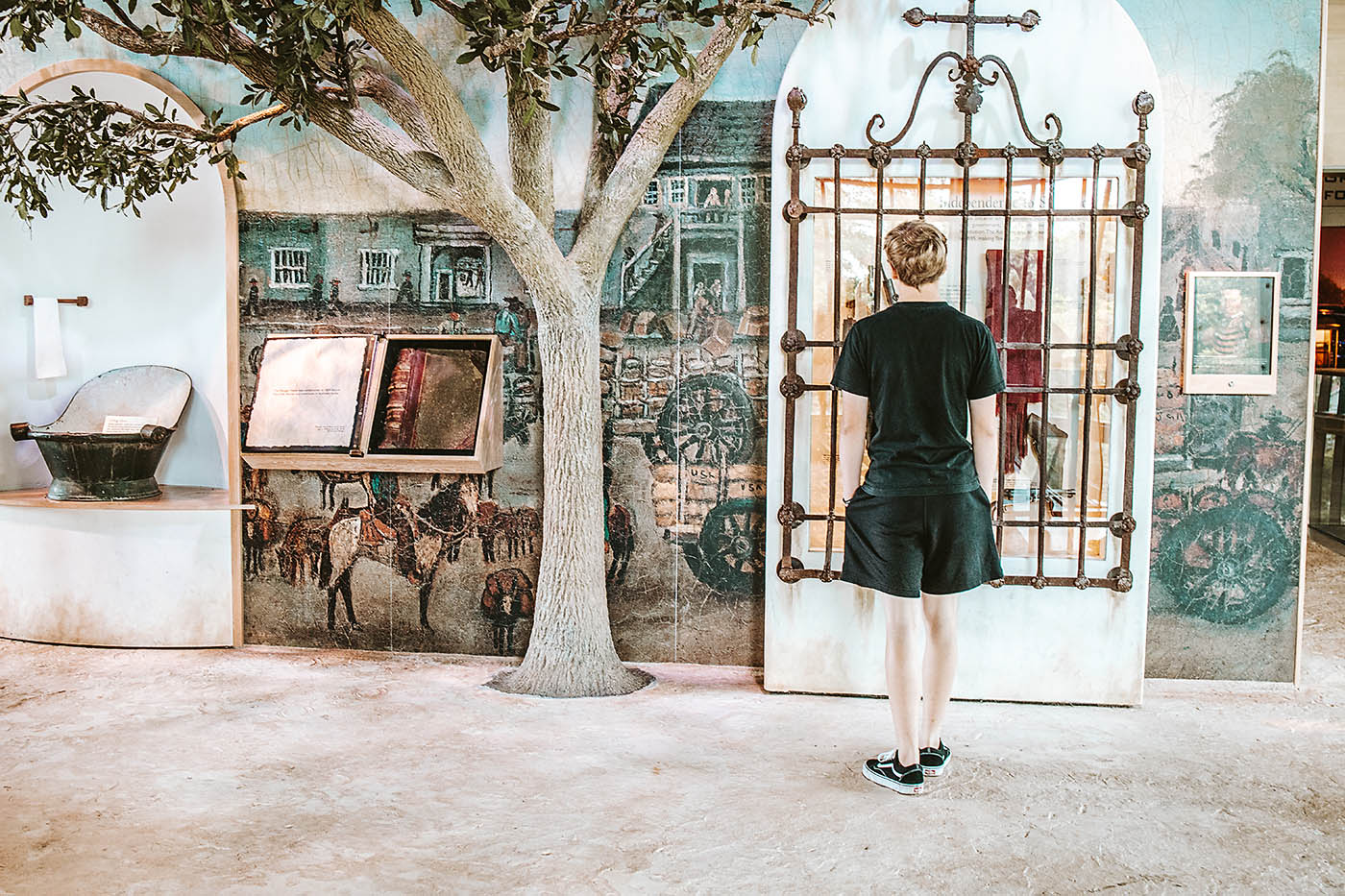 Teenaged Boy looking at San Antonio exhibit at a museum
